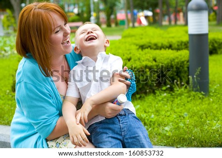 Portrait of happy mother and child outdoors #160853732