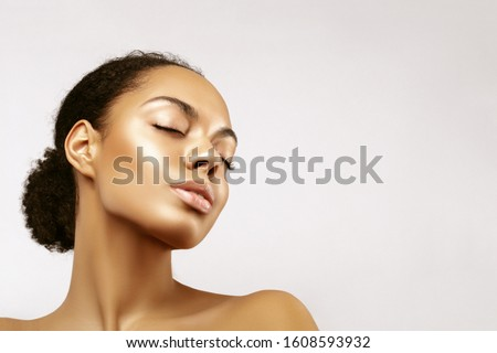 African American skincare models portrait. Beauty spa treatment concept.Young girl posing with closed eyes against grey background Royalty-Free Stock Photo #1608593932