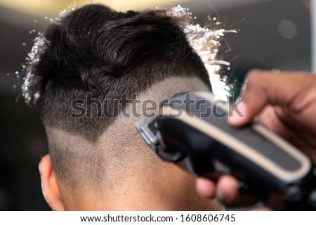 SHAVING MACHINE CUTTING HAIR FADE Royalty-Free Stock Photo #1608606745