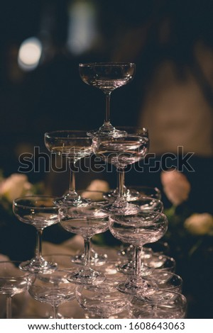 Stacked champagne pouring glass In weddings and celebrations, ideas for celebrations and festivals #1608643063