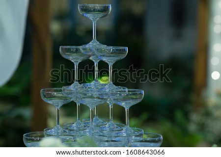 Stacked champagne pouring glass In weddings and celebrations, ideas for celebrations and festivals #1608643066