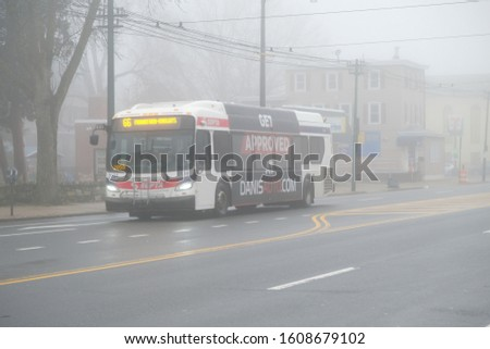 Philadelphia,PA/USA- January 4th 2020: Philadelphia had a very thick fog and it was a great chance to take photo of the septa bus. #1608679102