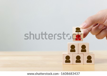 Human resource management and recruitment business concept, Hand flip over wood cube block on top pyramid, Copy space #1608683437