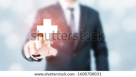 Businessman hand touching plus sign icon means to offer positive thing (like benefits, personal development, social network) #1608708031