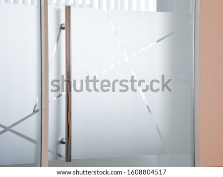 Glass Film Design. frosted film glass sticker cut in pattern, Modern office, Concept. Privacy in work place, Manager room. Glass wall idea for interior. Royalty-Free Stock Photo #1608804517