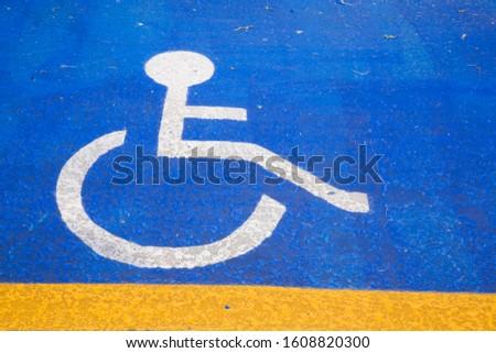 Handicapped parking, pictogram painted on an asphalt parking lot, Montréal, Quebec Province, Canada #1608820300