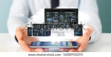 View of Businessman holding Devices connected to a cloud multimedia network 3d rendering #1608950293