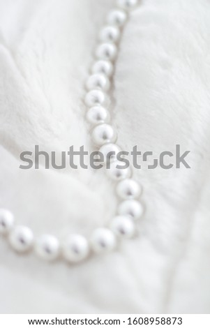 Jewelry branding, elegance and sale concept - Winter holiday jewellery fashion, pearl necklace on fur background, glamour style present and chic gift for luxury jewelery brand shopping, banner design #1608958873