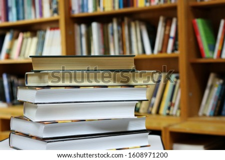 books on the table in public library #1608971200