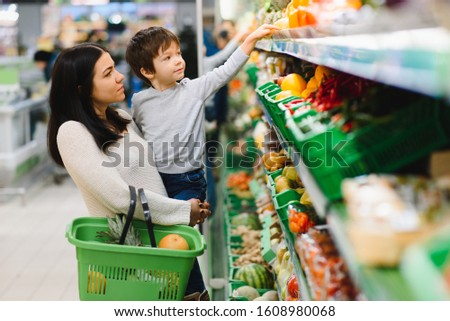 Young mother with her little baby boy at the supermarket. Healthy eating concept #1608980068