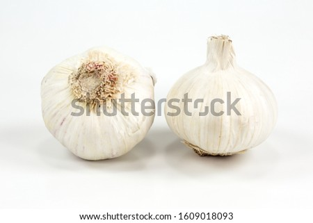 two closed white organic garlic bulbs with skin isolated on white background #1609018093