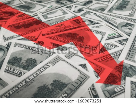 Red arrow icon on a background of money. The concept of changing course of US dollar on the market. Devaluation, collapse, stagnation of the economy. #1609073251