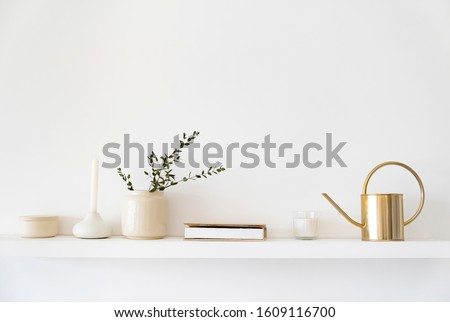 Minimalistic Scandinavian interior. Dishes on white shelves. White details in the interior. Royalty-Free Stock Photo #1609116700
