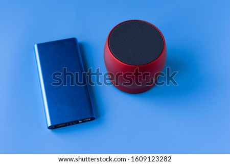 Power bank for charging mobile devices and devices. Blue smartphone charger with power bank. External battery for wireless headphones and speakers #1609123282