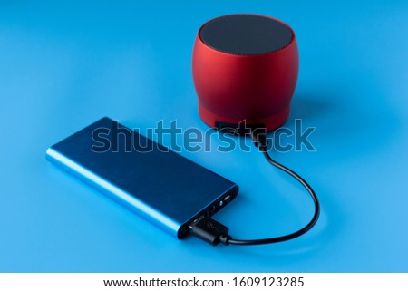 Power bank for charging mobile devices and devices. Blue smartphone charger with power bank. External battery for wireless headphones and speakers #1609123285