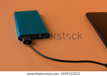 Power bank for charging mobile devices and devices. Blue smartphone charger with power bank. External battery for wireless headphones and speakers #1609123312