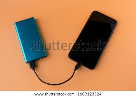 Power bank for charging mobile devices and devices. Blue smartphone charger with power bank. External battery for wireless headphones and speakers #1609123324