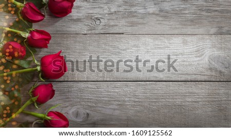 Roses on the old table. Valentine's Day background. #1609125562