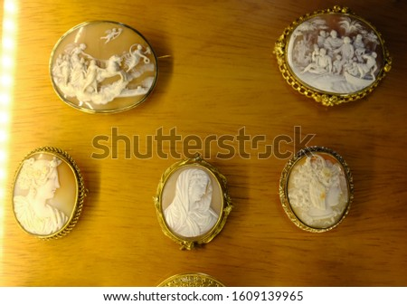 A variety of antique cameos carved from shell in intricate detail. #1609139965