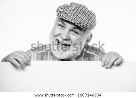 cheerful grandpa. job search. Need help. wanted. Copy space placate information. happy mature man in retro hat. Advertisement. Advertisement shop. Senior bearded man place announcement on banner. #1609146604