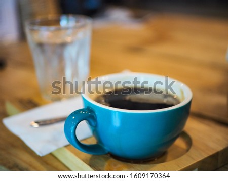 Blue cup black coffee in cafe #1609170364