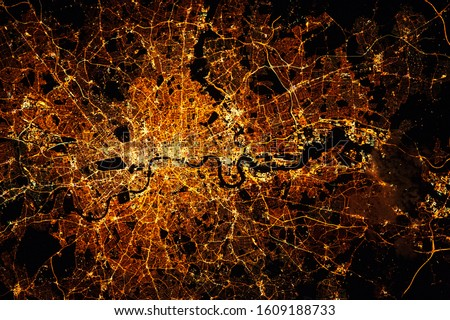 LONDON city lights map at night. Satellite view. Aerial view of London. Global communications and networking. Cyberspace in big city.  Mixed media Royalty-Free Stock Photo #1609188733