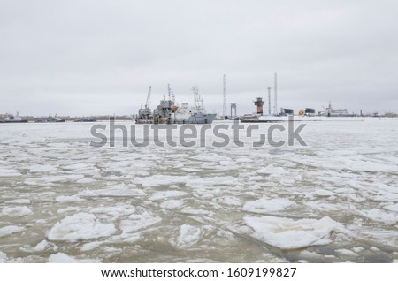 Winter port in Severodvinsk. Ice on the White Sea. Warships and submarines #1609199827