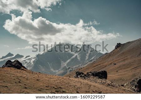 seven glacier on the background of the Caucasus ridge
