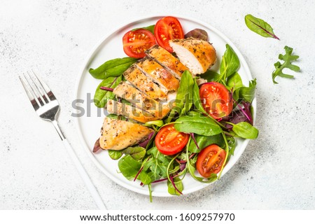 Chicken fillet with salad. Healthy food, keto diet, diet lunch concept. Top view on white background. #1609257970