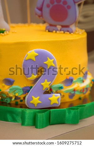 Cake with cartoon characters for a children's birthday.