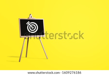 Sign stand with an arrow in the target on background. #1609276186