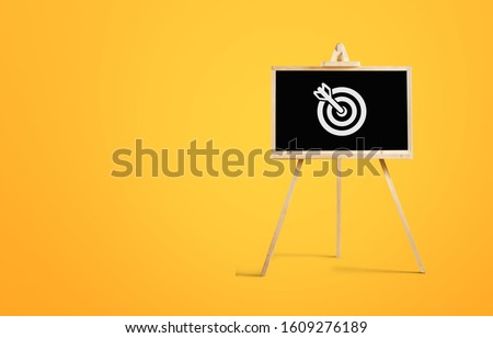 Sign stand with an arrow in the target on background. #1609276189