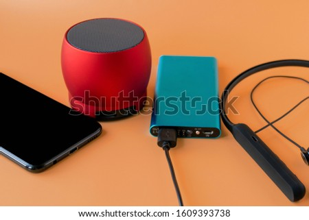 Power bank for charging mobile devices and devices. Blue smartphone charger with power bank. External battery for wireless headphones and speakers #1609393738