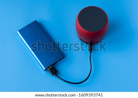 Power bank for charging mobile devices and devices. Blue smartphone charger with power bank. External battery for wireless headphones and speakers #1609393741