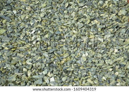 Stone chips (granite or marble) for decorative mulching. Decorative mulch for landscape design. #1609404319