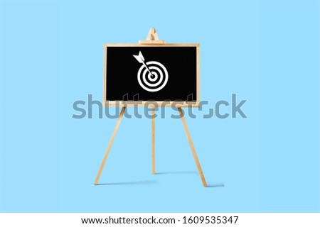 Sign stand with an arrow in the target on pastel background. #1609535347