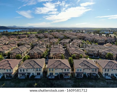Aerial view of upper middle class neighborhood with identical residential subdivision houses during sunny day in Chula Vista, California, USA. #1609581712