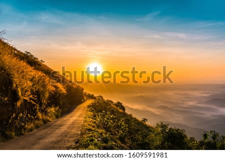 Dramatic sunrise view at Kerala God's own country colorful nature scenery from Palakkayam Thattu, Travel and tourism concept image best place to visit in Kannur #1609591981