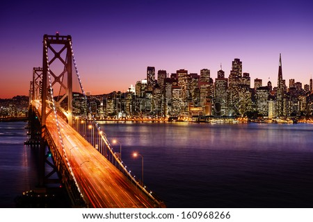 San Francisco skyline and Bay Bridge at sunset, California #160968266