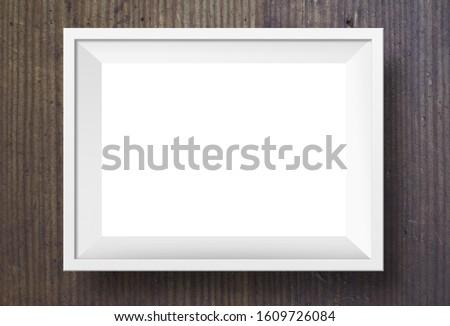 White photo frame on dark wood background