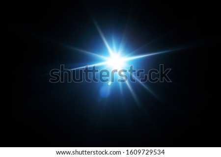 Easy to add lens flare effects for overlay designs or screen blending mode to make high-quality images. Abstract sun burst, digital flare, iridescent glare over black background. Royalty-Free Stock Photo #1609729534