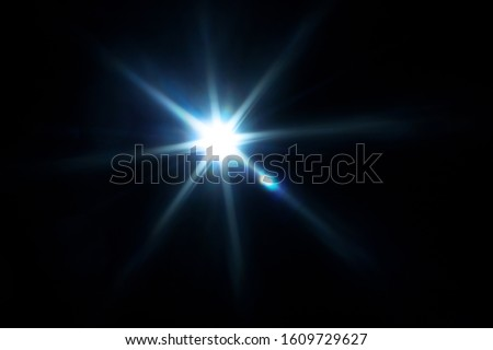 Easy to add lens flare effects for overlay designs or screen blending mode to make high-quality images. Abstract sun burst, digital flare, iridescent glare over black background. Royalty-Free Stock Photo #1609729627