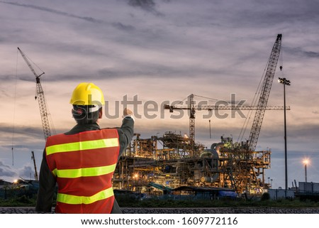 Worker man watching some details on construction #1609772116