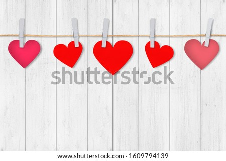Paper red hearts border on white wood background, copy space. Valentine's Day composition concept. #1609794139