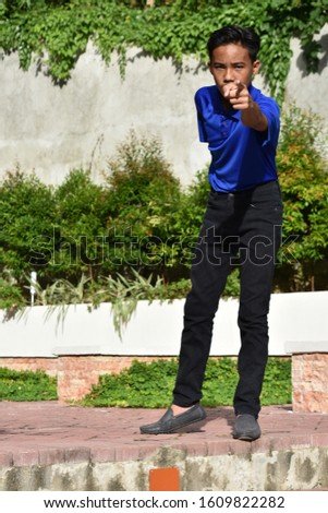 A Young Diverse Male Pointing #1609822282
