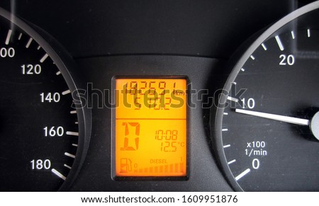 Car dashboard is a control panel usually located directly ahead of a vehicle's driver, displaying instrumentation and controls for the vehicle's operation. #1609951876