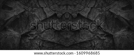 Black stone background. Black and white grunge background. Old black stone wall. Grunge banner. Dark gray stone background. Geometric stone pattern. Fantasy ancient gate arch castle fortress wall .