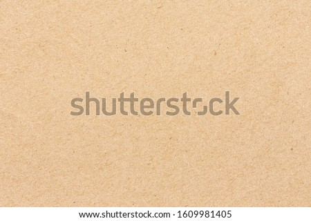 Brown cardboard sheet of paper background Royalty-Free Stock Photo #1609981405
