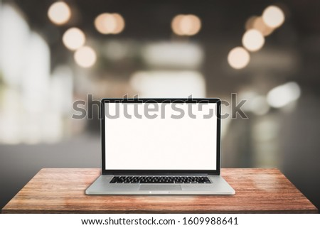 3D Rendering, laptop on wooden table with blur background
