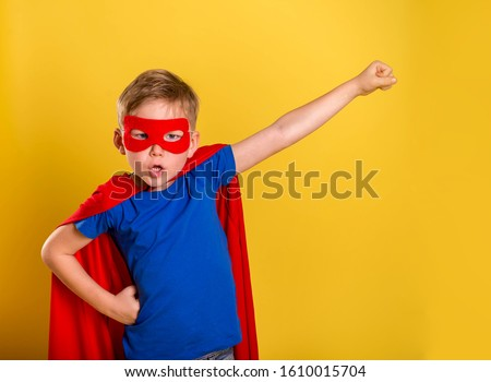 Little child boy play superhero. Happy smiling kid in glasses with star. Success, motivation concept.  #1610015704